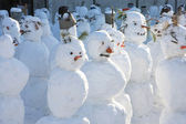 Snowmen crowd — Stock Photo