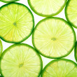 Green lime slices background — Stock Photo