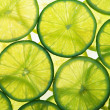 Green lime slices in many layers — Stock Photo