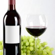 Bottle and glass of red wine and grapes — Stock Photo
