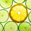 Yellow lemon and green lime slices — Stock Photo