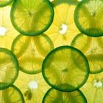 Yellow lemon and green lime slices — Stock Photo #1235740