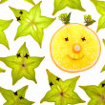 Starfruit (carambola) slices with orange — Stock Photo #1237299