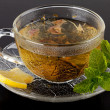 Stock Photo: Cup of green tea with lemon and mint