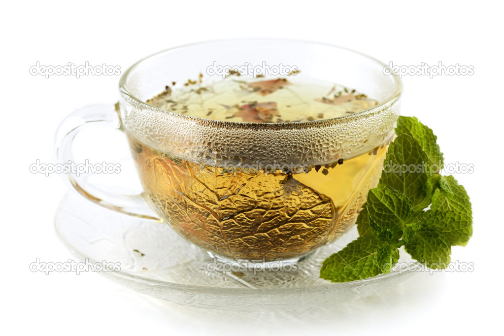 Cup of green tea with lemon and mint isolated on white — Stock Photo #1415088