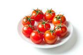 Fresh Cherry Tomatoes on plate — Stock Photo
