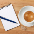 Blank notepad with pen and cappucino cup — Stock Photo
