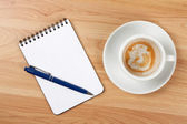 Blank notepad with pen and empty coffee — Stock Photo