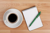 Espresso cup with blank notepad and pen — Stock Photo