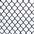 Foto Stock: Black metal grate again white