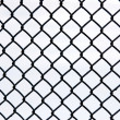 Black metal grate again white - Stock Photo