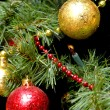 Christmas balls on the fur-trees branch — Stock Photo