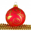Red christmas ball and golden garland — Stock Photo