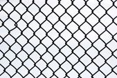 Black metal grate again white — Stock Photo