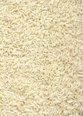 Uncooked white rice background — Stock Photo