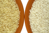 White and yellow (parboiled) rice — Stock Photo