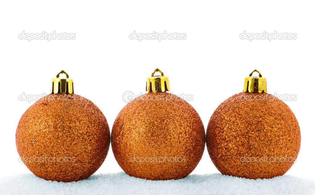 Three golden christmas balls in a snow isolated on white — Stock Photo #1254809