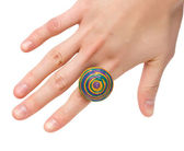 Female hand with colored ring — Stock Photo