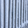 Fence in snow - Stock Photo
