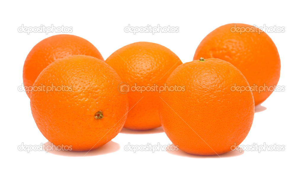 Five ripe juicy oranges on white background. Isolated. Shallow DOF. — Stock Photo #1432619