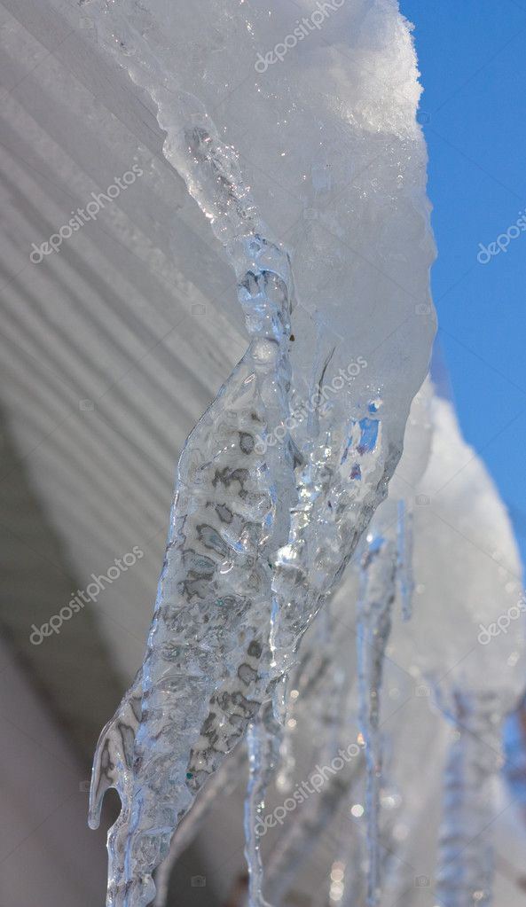 Icicles on the eaves.   Stock Photo #1433168