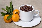 Mandarin and coffee — Stock Photo