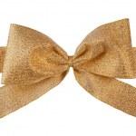 Gold gift brocade ribbon bow — Stock Photo