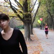 Two girls at autumn park — Stock Photo