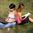 Girls with laptop and book — Stock Photo