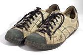 Worn white shoes — Stock Photo