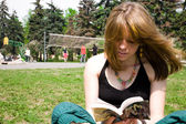 Pretty young women reading a book — Stock Photo
