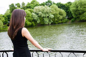 Young woman on the bridge — Stock Photo