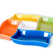 Five colored sauce-boats - Stock Photo