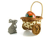 Hare near a basket with easter egg on wh — Stock Photo