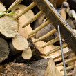 Stacked wood logs and rake - Lizenzfreies Foto
