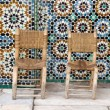 Two chairs on tiles background — Stock Photo