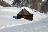 Alpine wooden house in the snow — Stock Photo