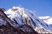 Windy snowy peak — Stock Photo