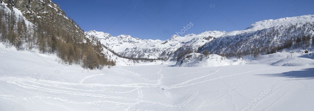 Icy alpine lake landscape full of snow; Alps, Italy  Stock Photo #1253876