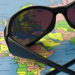 Royalty-Free Stock Photo: Sunglasses on the bright map