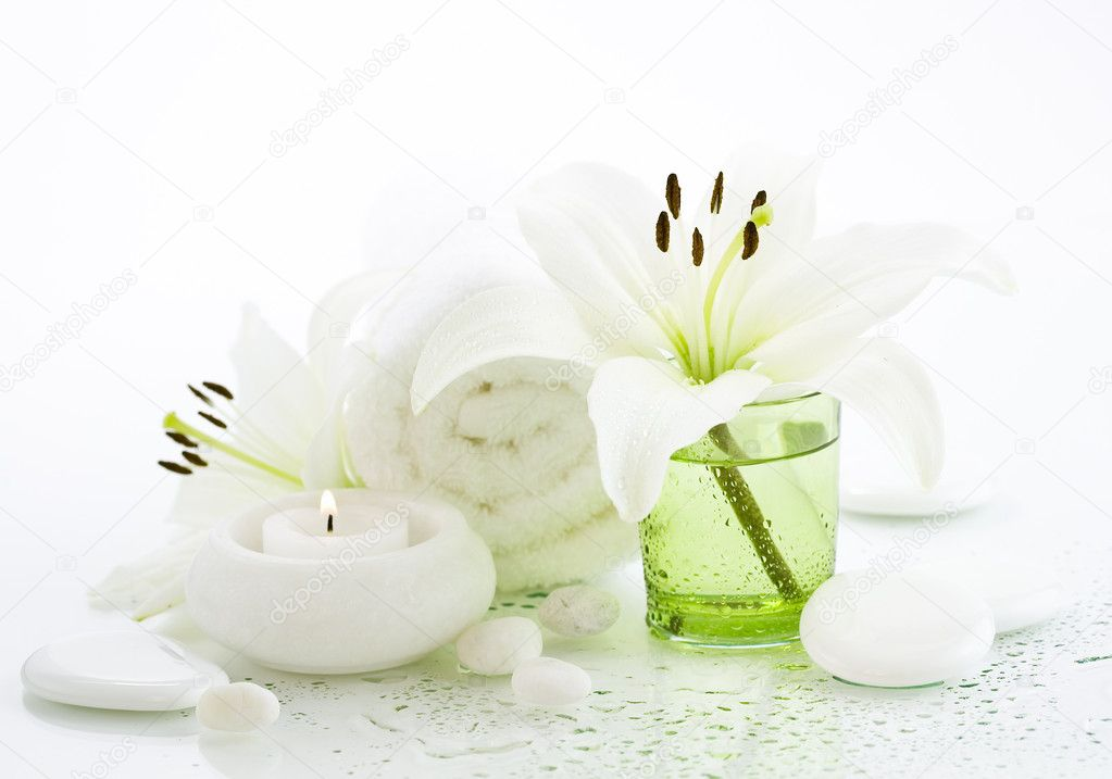 Spa concept (flowers, towel, candle and pebbles). White background — Stock Photo #1263308
