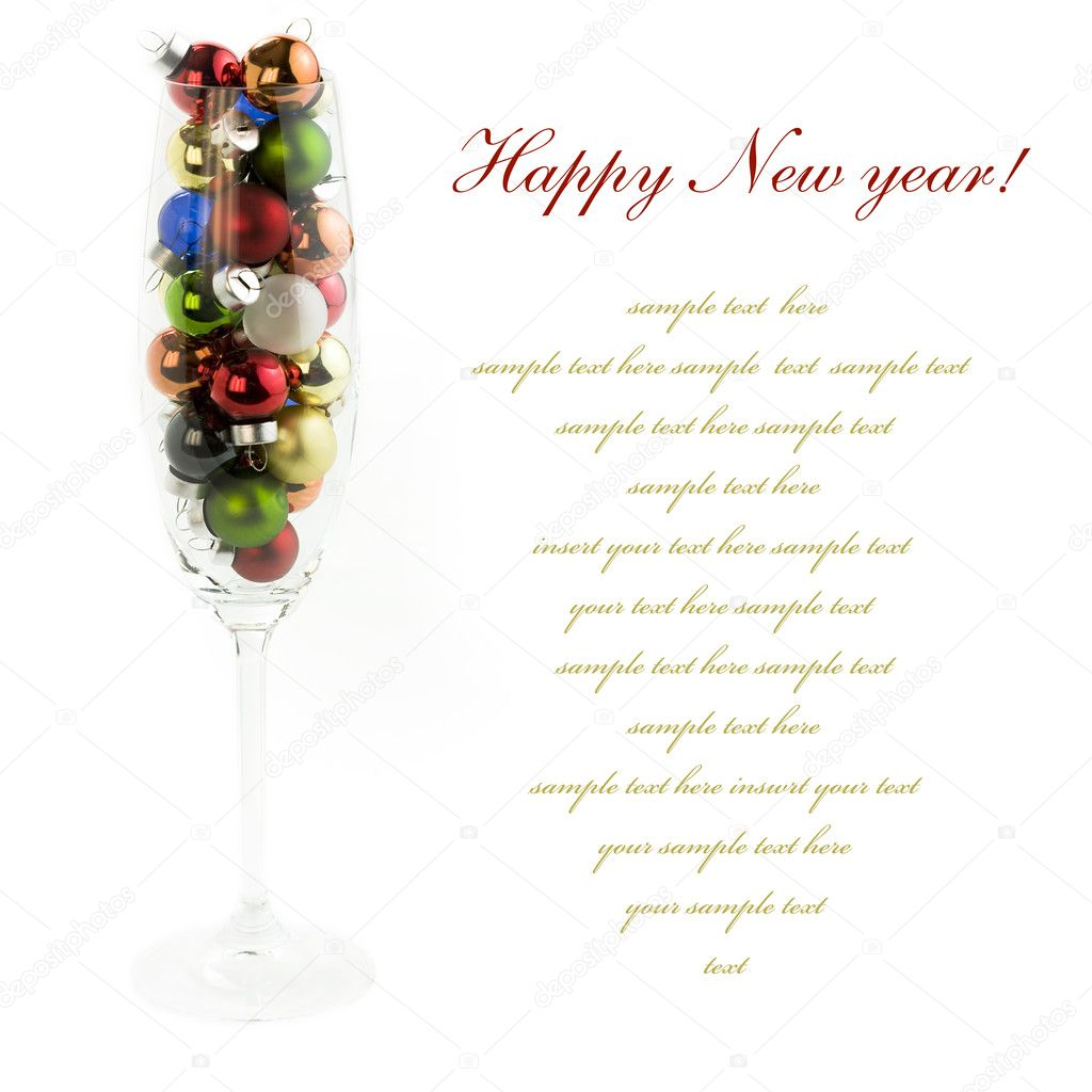 Champagne glass filled with colorful holiday ornaments over white — Stock Photo #1397950