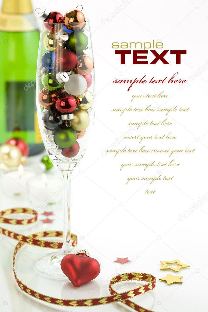 Champagne glass filled with colorful holiday ornaments, bottle of champagne and christmas decoration over white  Stock Photo #1398100