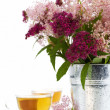 Herbal tea and flowers - Foto Stock
