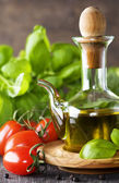 Olive oil, basil and vegetables — Stock Photo