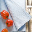 Fork and peppers on blue napkin — Stock Photo