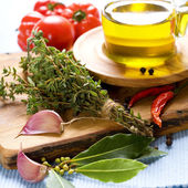 Bottle of Olive oil and condiments — Stock Photo