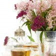 Herbal tea and flowers — Stock Photo