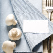 Fork and mushrooms on blue napkin — Stock Photo