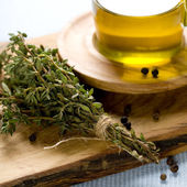 Rosemary and olive oil — Stock Photo